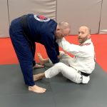 Hand on Collar while in Butterfly Guard-Partner Standing up