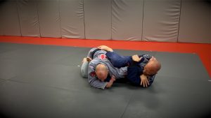crunch up to tap for the armbar