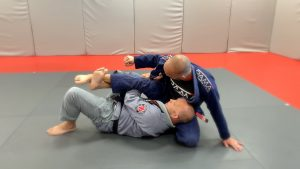 pass lapel to the back hand