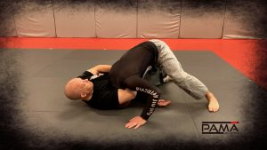 As you sit back you'll squeeze both for the choke and on his leg.