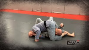 Leg over head, hooking feet for triangle
