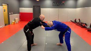 opponent locks up, stiff arms