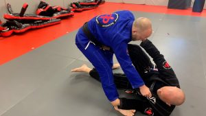#5- Making sure that right foot is in the hip so when you sweep you are able to push opponent backward.