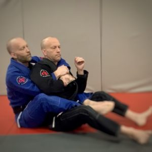 Going for choke using Kimura Grip