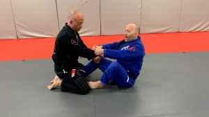 start in butterfly guard with sleeve control