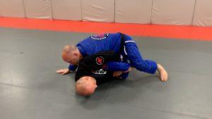 Knee slice, hand to floor to stabilize.