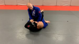Control Sleeve. One hand goes under opponent's leg