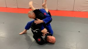 Here is where you would go for the armbar. Making sure to lift your hips.