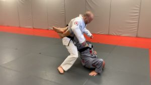 Step #3: As you drive your hips up and over the leg that your trapping, we're bringing him back to the floor.