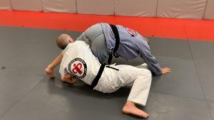 Step #5: Raise hips, lift leg over opponents head.