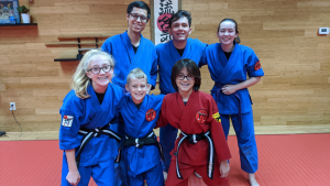 kids instructors and students hanging out and smiling