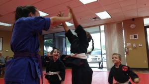 martial arts teacher having fun with the kids
