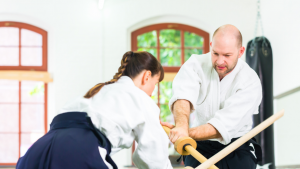 two students training with wooden swords