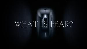 A dark hall way with the words, what is fear?