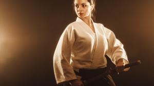 Confident woman holding a samurai sword