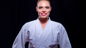 female martial artist sitting and smiling