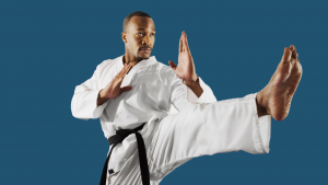 male martial artist doing a front kick