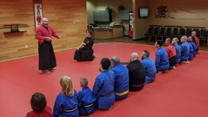 Kaiso presenting to his students in the dojo