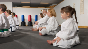 martial arts class mixed with adults and kids