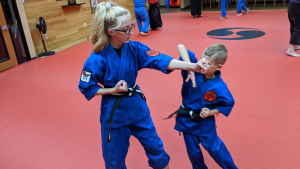 two kids training karate together