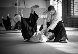 two male aikido students training together