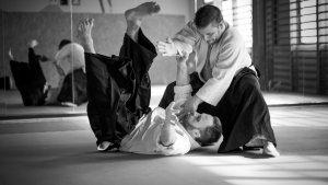 aikido student throwing another student